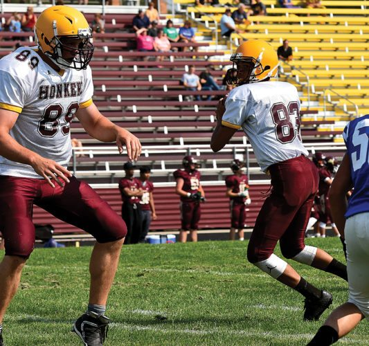 Garrick Hodge/MDN Kenmare quarterback Tevin Dix (83) steps back into the pocket in a scrimmage against Stanley last week in Minot.