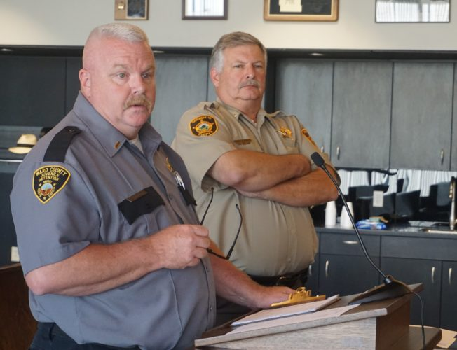Jill Schramm/MDN Mark Schrader, Ward County Juvenile Detention administrator, left, and Sheriff Bob Barnard speak to the Ward County Commission about 2018 budget requests Monday.