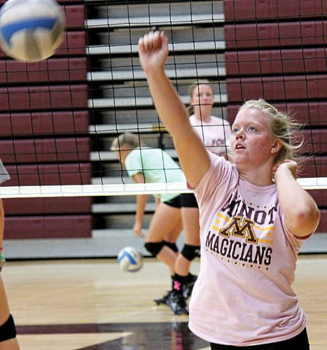 Alex Eisen/MDN Senior outside hitter Kali Askvig hits a volleyball during practice Monday at Minot High School.