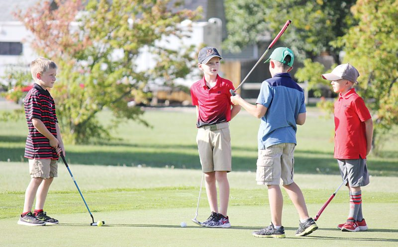 Alex Eisen/MDN  A group of kids gather on the practice putting green before the final tournament at the Jack Hoeven Wee Links this season in Minot. The tournament, sponsored by Marketplace Foods, featured boys and girls between the ages of 4-13.