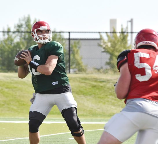 Garrick Hodge/MDN Minot State quarterback Zac Cunha prepares to throw a pass during a college football practice Wednesday in Minot.