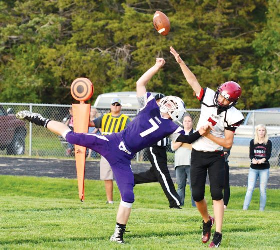 Matthew Semisch/Bottineau Courant Nedrose defensive back Ethan Miller breaks up a pass intended for Bottineau's Adam Monson Friday at Les Christian Field. Bottineau won 40-12.