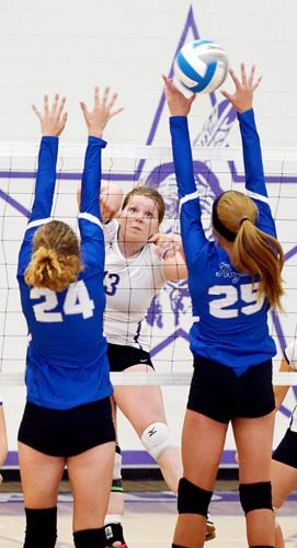 Matthew Semisch/Bottineau Courant Bottineau's Lexi Gullett tries to hit the ball beyond South Prairie's Madison Cooper (24) and Taryn Faul (25) on Tuesday in Bottineau. Bottineau won 3-0.