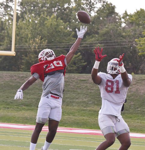 Garrick Hodge/MDN Minot State defensive back Mikael Bradford (29) tries to knock down a pass while tight end Devon Owens (81) completes his route during a college football practice last week in Minot.