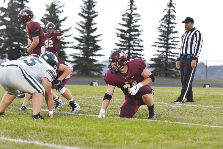 Garrick Hodge/MDN Minot High offensive lineman Logan Krueger (74) prepares for a play during a high school football game on Aug. 25 at Duane Carlson Stadium.