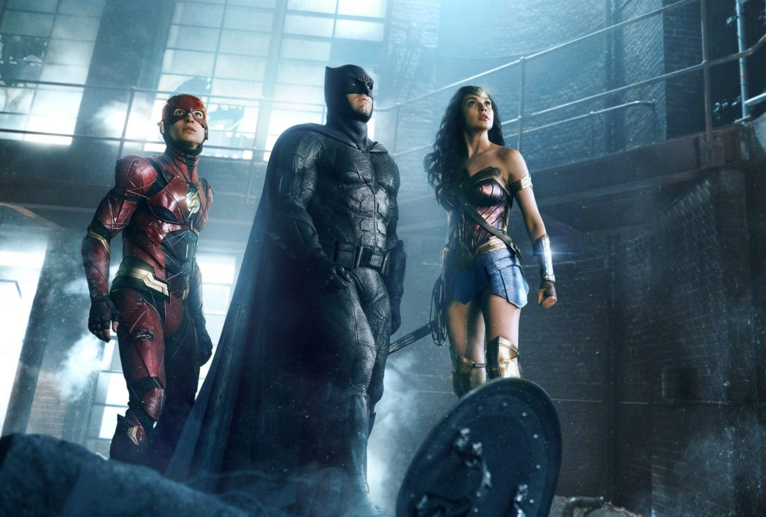 "This image released by warner Bros. Pictures shows Ezra Miller, from left, Ben Affleck and Gal Gadot in a scene from ""Justice League."""