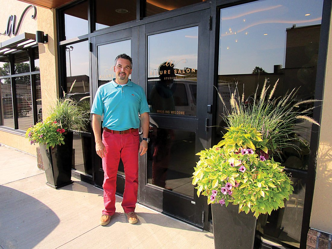 Ashton Gerard/MDN Owner Willy Fielhaber stands outside of Allure Salon Studios at the Grand Opening last Tuesday.