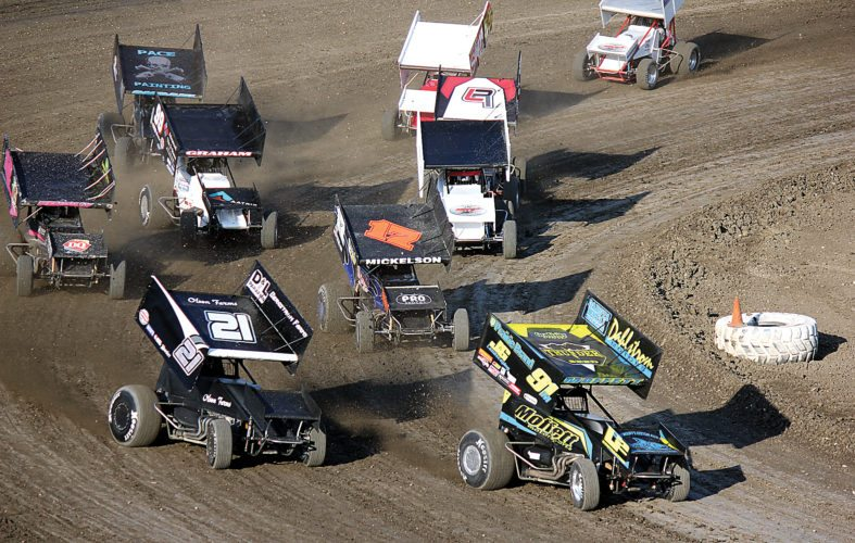 Alex Eisen/MDN Fargo's Jackson Moffett (91M) leads a pack of sprint cars to the green flag in a heat race Sunday night at Nodak Speedway.