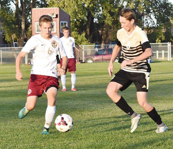 Garrick Hodge/MDN Minot High's Wyatt Markle (6) controls the ball during a high school soccer match Tuesday in Minot.