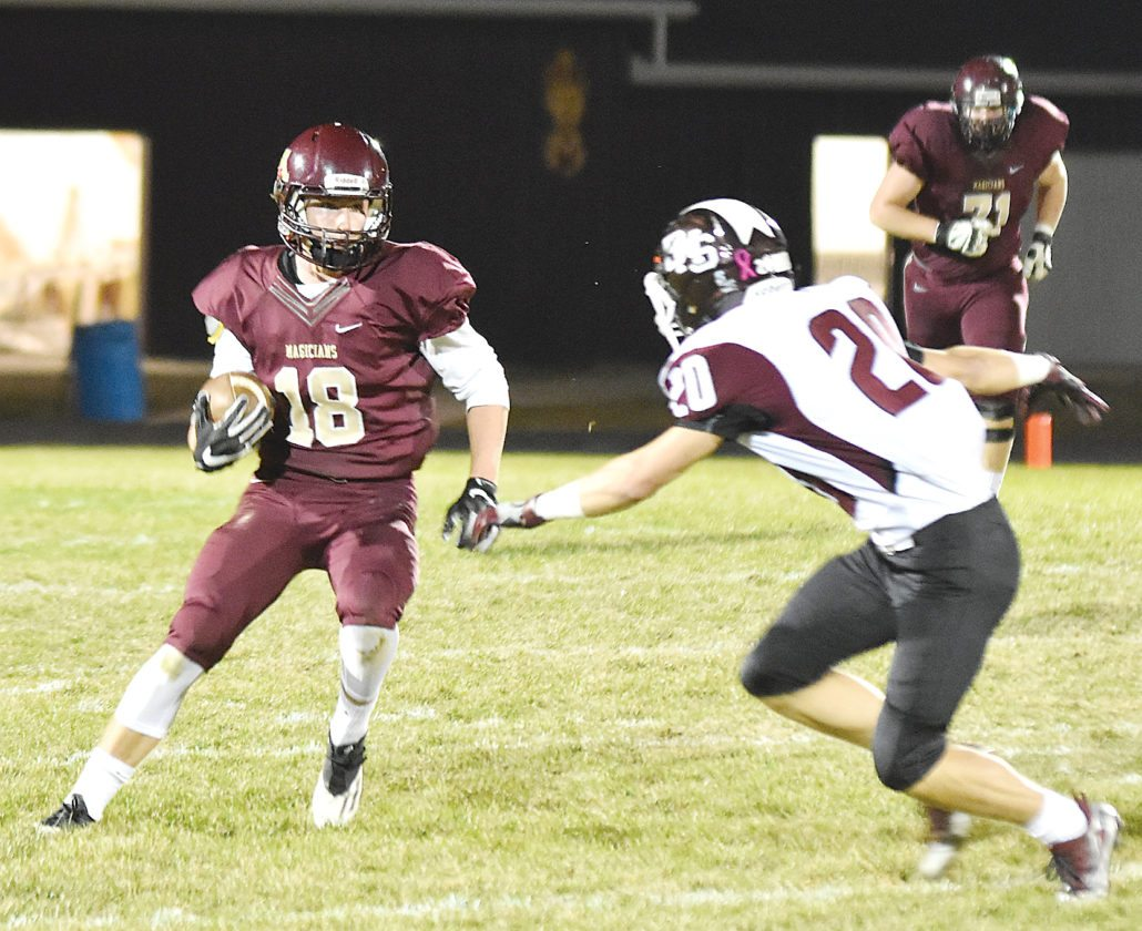 MDN file photo Minot wideout Peyton Lamoureux takes a handoff during last year's playoff game against Bismarck.