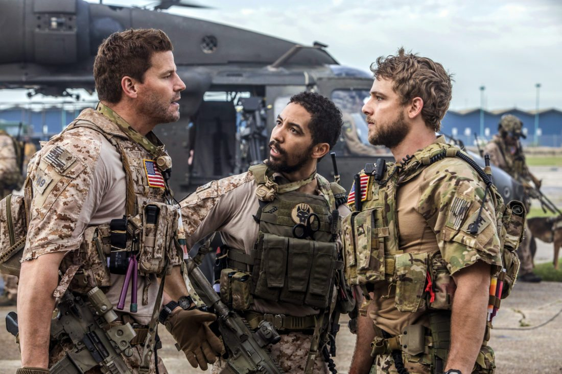 """This image released by CBS shows David Boreanaz, from left, Neil Brown Jr. and Max Thieriot in a scene from """"SEAL Team,"""" premiering Sept. 27, on CBS. (Skip Bolen/CBS via AP)"""