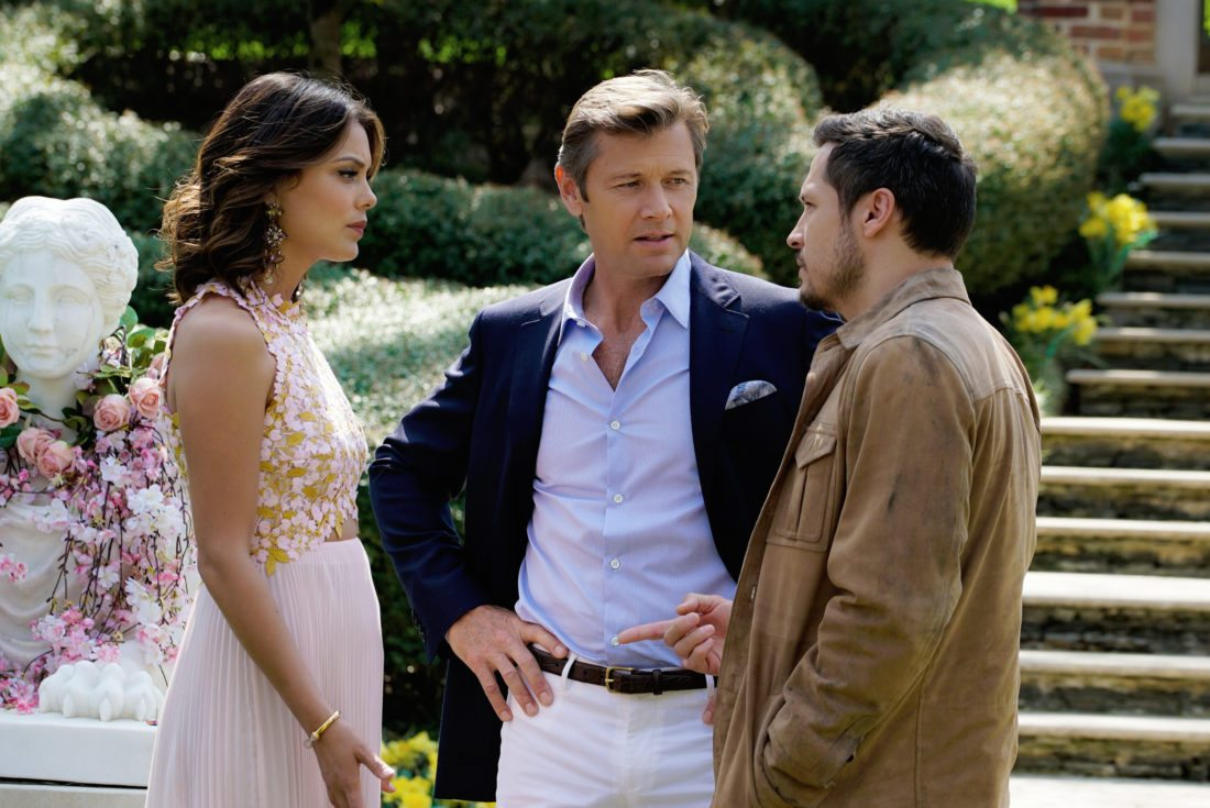 """This image released by The CW shows, from left, Nathalie Kelley, Grant Show and Nick Wechsler in a scene from """"Dynasty,"""" premiering Oct. 11 on The CW. (Jace Downs/The CW via AP)"""