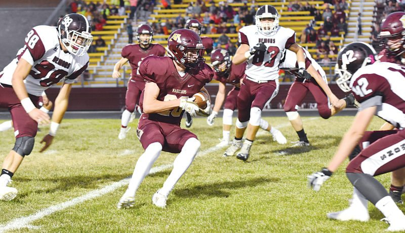 Garrick Hodge/MDN Minot High's Kyler Stenberg (20) returns a punt during a high school football game Friday at Duane Carlson Stadium in Minot.