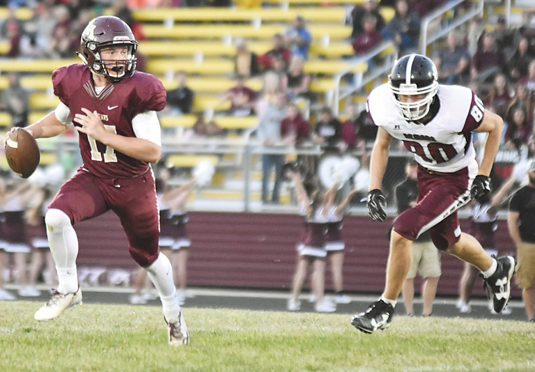 Garrick Hodge/MDN MHS quarterback Creighton Rudolph (17) rolls out to attempt a pass.