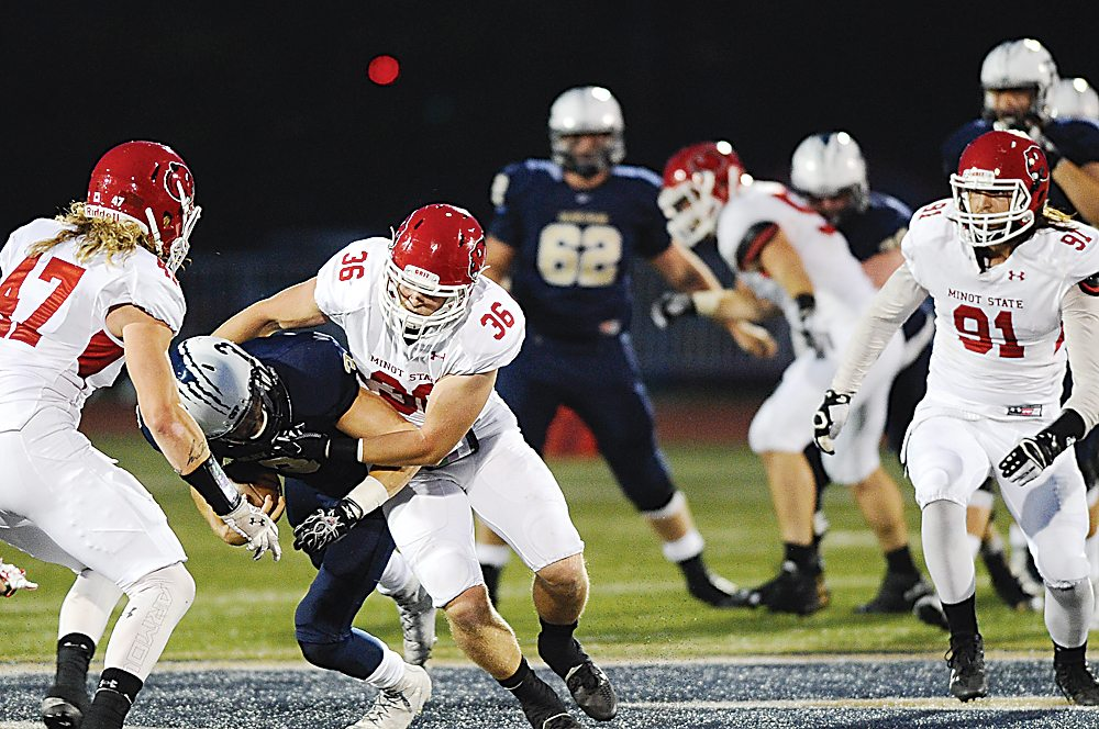 Minot State linebacker Matt Marler (36) makes a tackle during the Beavers season opener at Concordia St. Paul on Sept. 1 in St. Paul, Minn.  Photo courtesy of Justin Oakman Photography