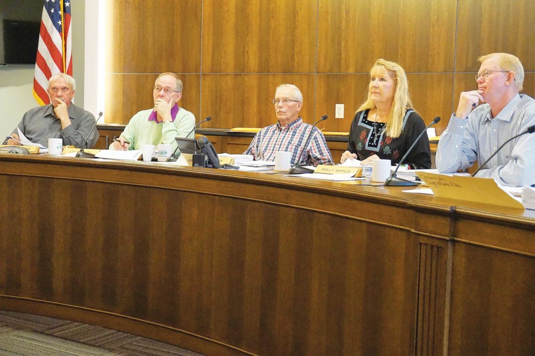 FilePhoto  John Fjeldahl, Larry Louser, Alan Walter, Shelly Weppler and Jim Rostad meet as the Ward County Commission April 18, a week after a closed meeting regarding the sheriff's resignation.