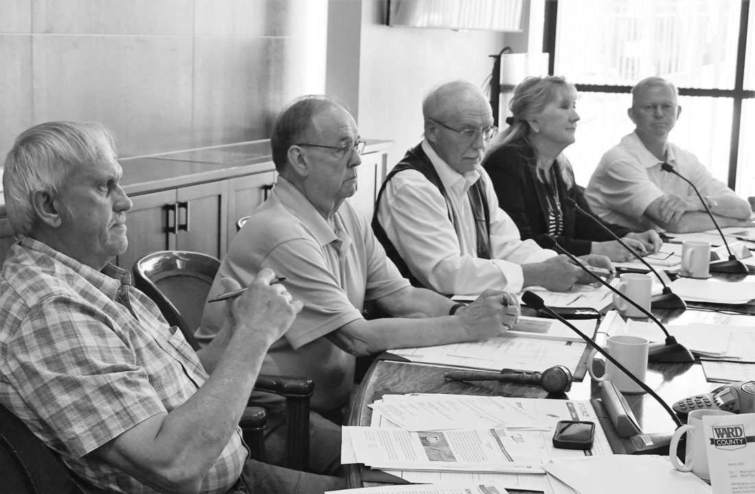 FilePhoto  Ward County Commissioners John Fjeldahl, Larry Louser, Alan Walter, Shelly Weppler and Jim Rostad conduct business at a meeting June 20.
