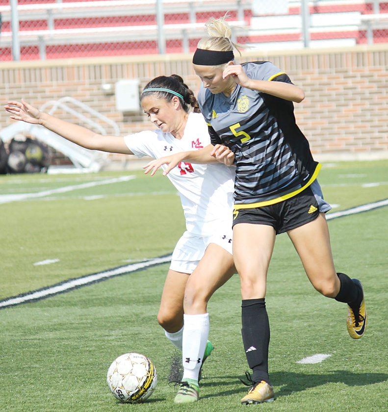 Alex Eisen/MDN MSU freshman midfielder Sofia Lewis (15) shields off a Fort Hays State defender Sunday in a nonconference game.