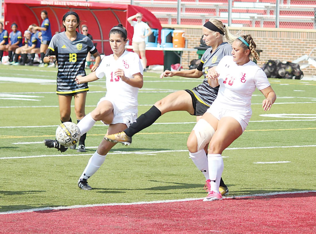 Alex Eisen/MDN Minot State senior Gabrielle Kwiatek (13) attempts a shot in front of Fort Hays State defender Paige Utterback (5) and MSU teammate Sydnee Canales (10) on Sunday at Herb Parker Stadium.