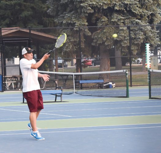 Garrick Hodge/MDN Minot High's Peyton Huss lifts a forehand during a high school tennis match Tuesday at Hammond Park in Minot.