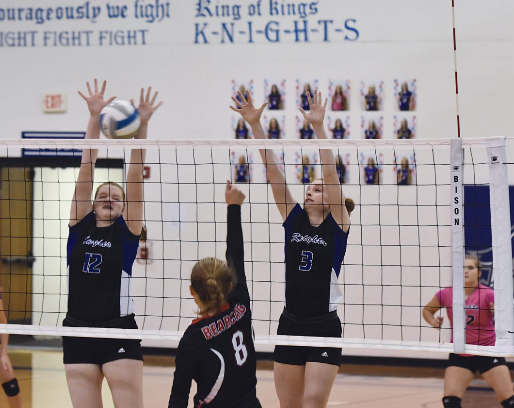 Our Redeemer's volleyball players Annie Folden (12) and Karolynn Winger (3) go up for a block during a girls high school volleyball game Tuesday in Minot. ORCS defeated North Star 3-0.  Garrick Hodge/MDN
