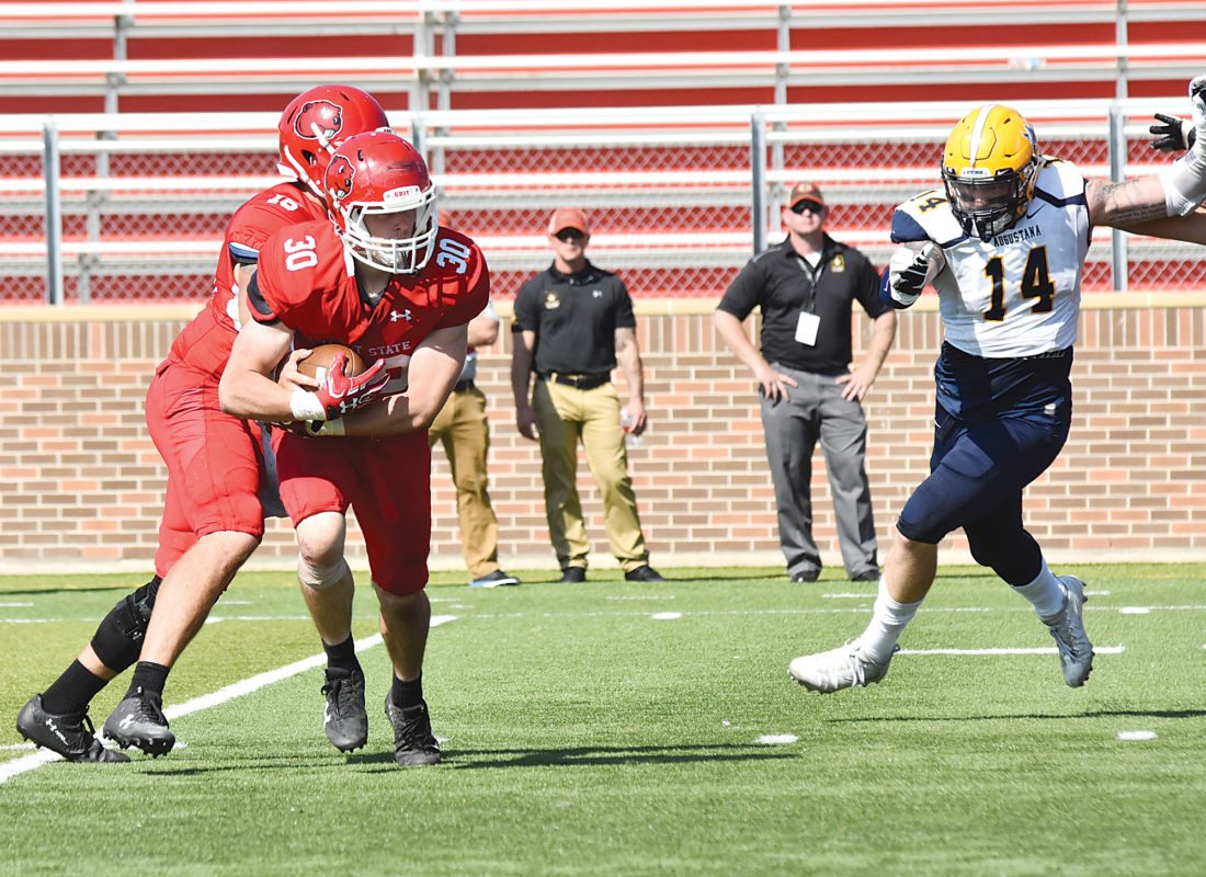Garrick Hodge/MDN Minot State running back Hayden Van Winkle (30) takes a handoff during a college football game Saturday at Herb Parker Stadium in Minot.
