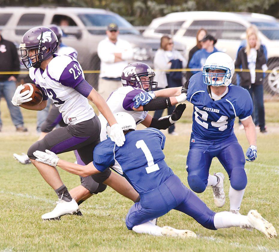 Garrick Hodge/MDN North Prairie running back Gabe Leonard (23) runs through a tackle during a high school football game last season.