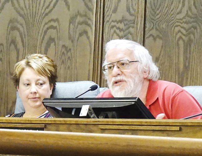 Jill Schramm/MDN Council member Stephan Podrygula, right, speaks at Thursday's meeting as council member Lisa Olson looks on at left.