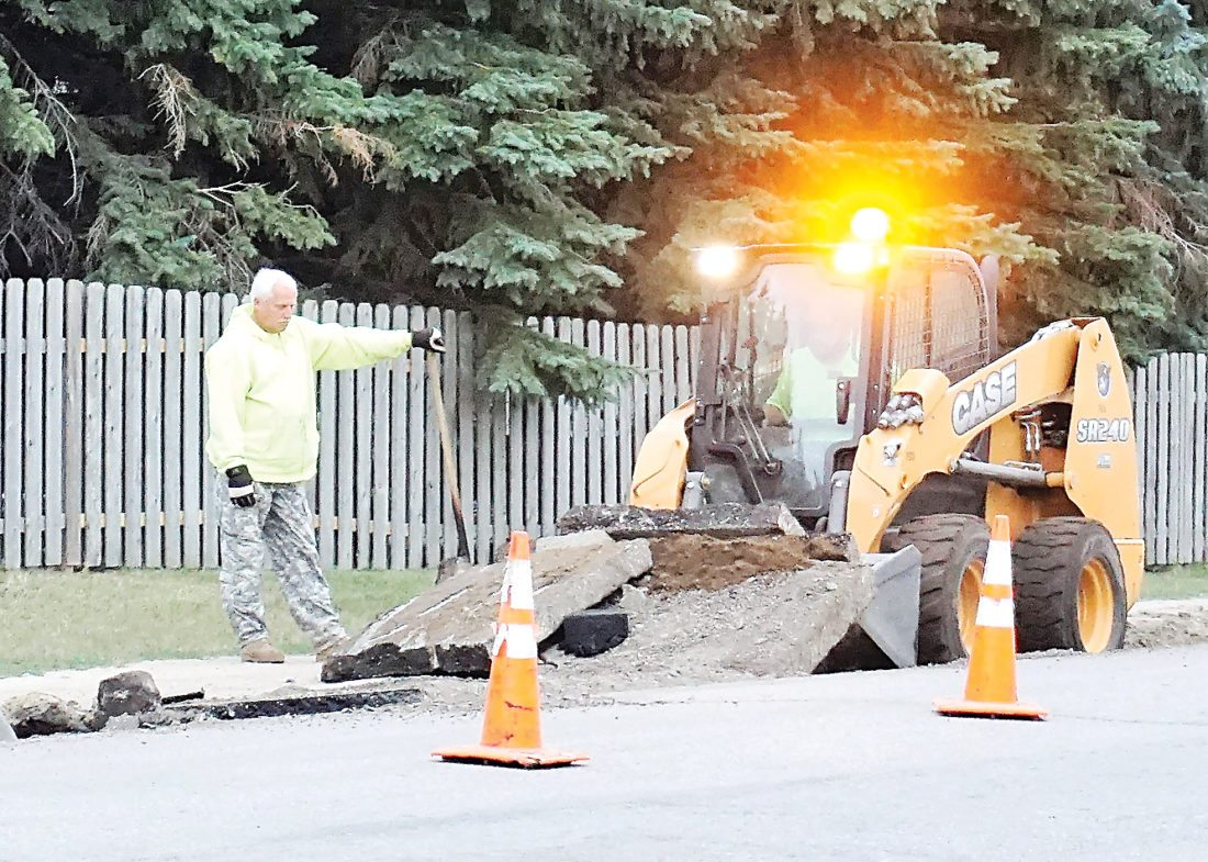Jill Schramm/MDN City employees work on repairs to the landfill road in southwest Minot last week.