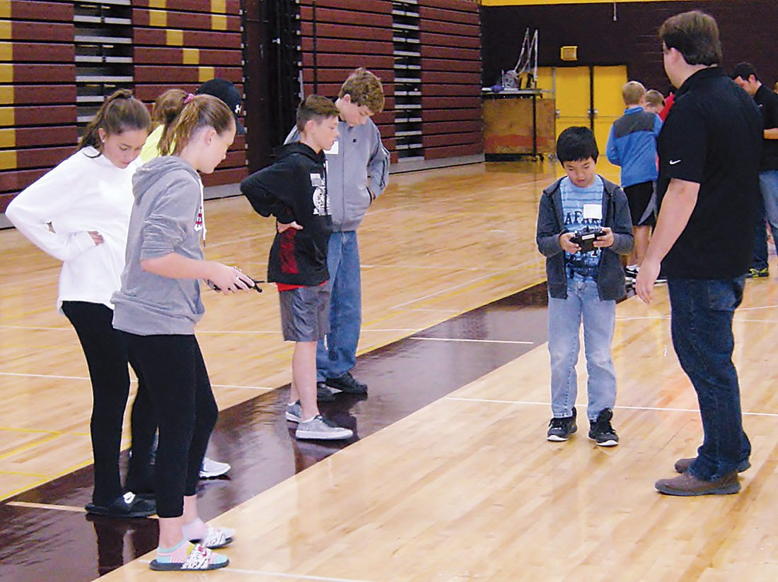 Andera Johnson/MDN Kids fly drone planes during the Scandinavian Youth Camp on Saturday.