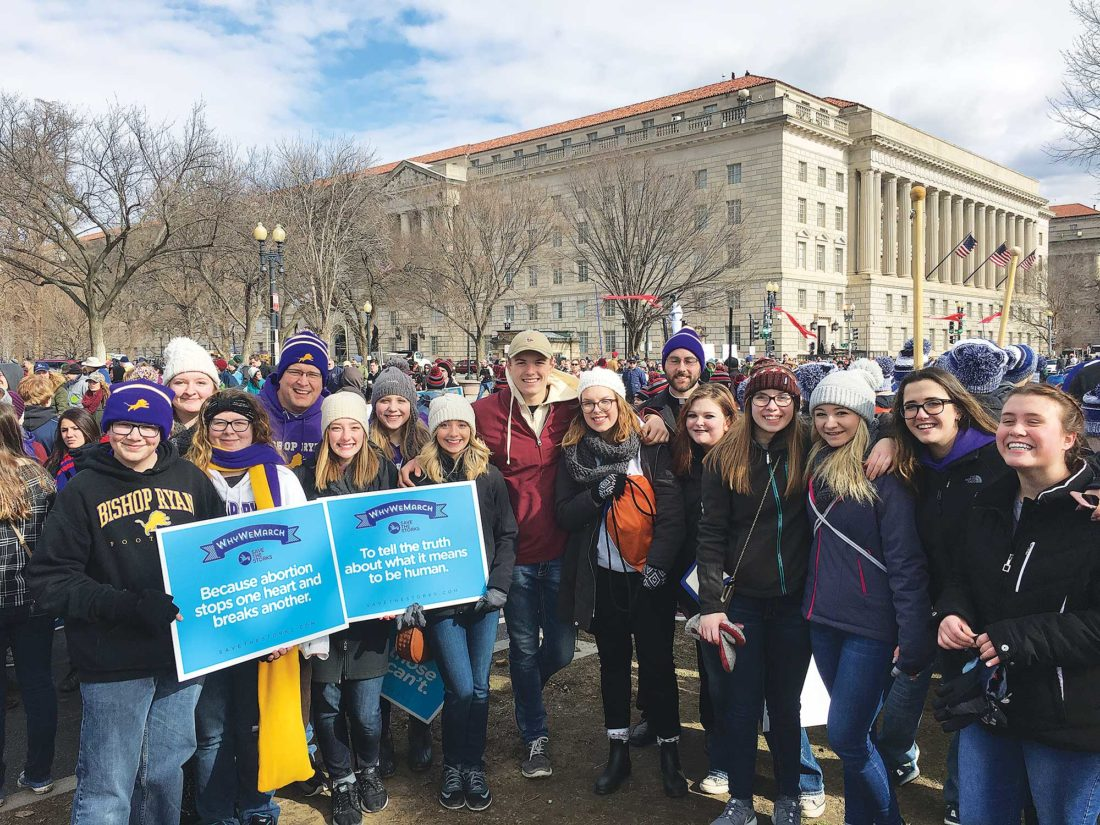Submitted Photo Representatives from Bishop Ryan High School pose for a photograph during the March for Life Jan. 27 in Washington, D.C. Sommer Bradley is fourth from right and McKenna Beeter is sixth from left.