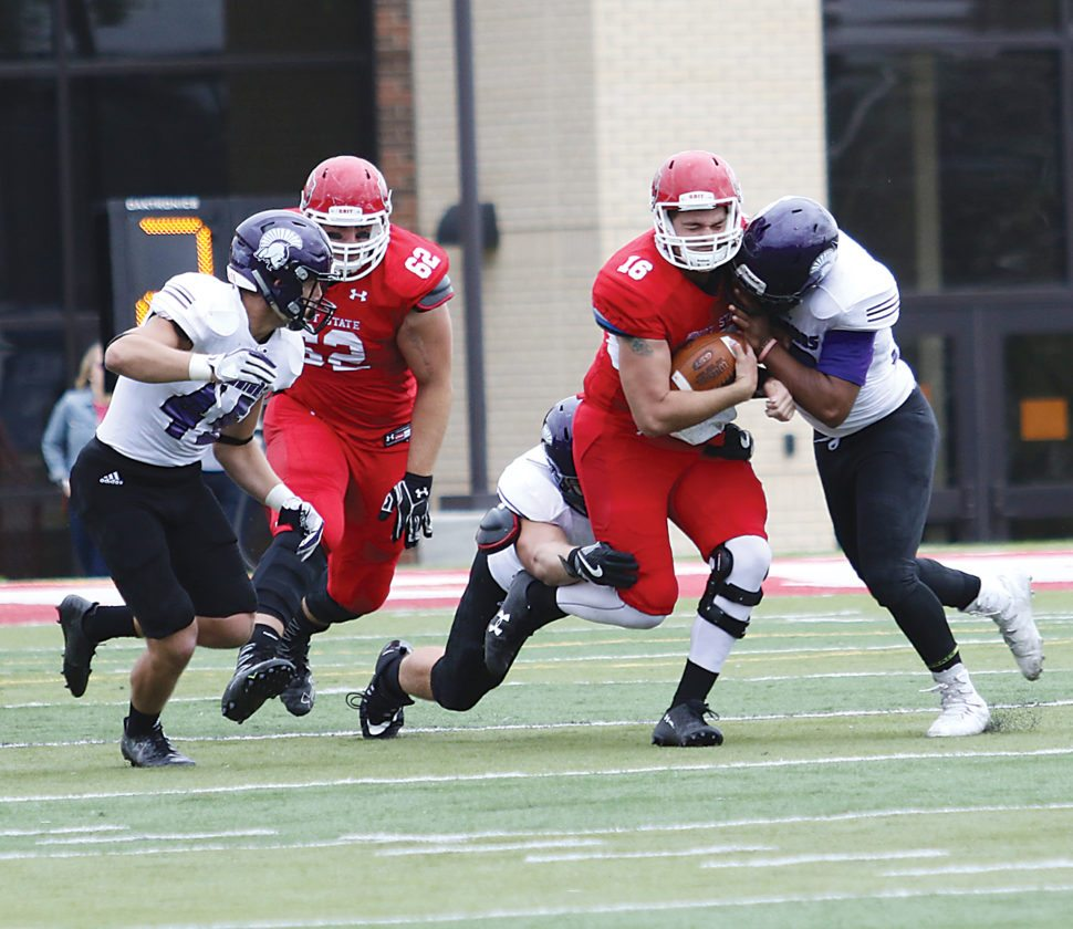 Garrick Hodge/MDN Minot State quarterback Zac Cunha is sacked during a college football game Saturday.