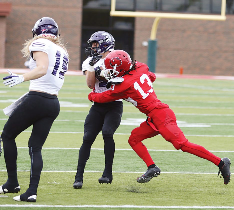 Garrick Hodge/MDN Minot State's Kiante Goudeau (13) makes a tackle during a college football game Saturday at Herb Parker Stadium in Minot.