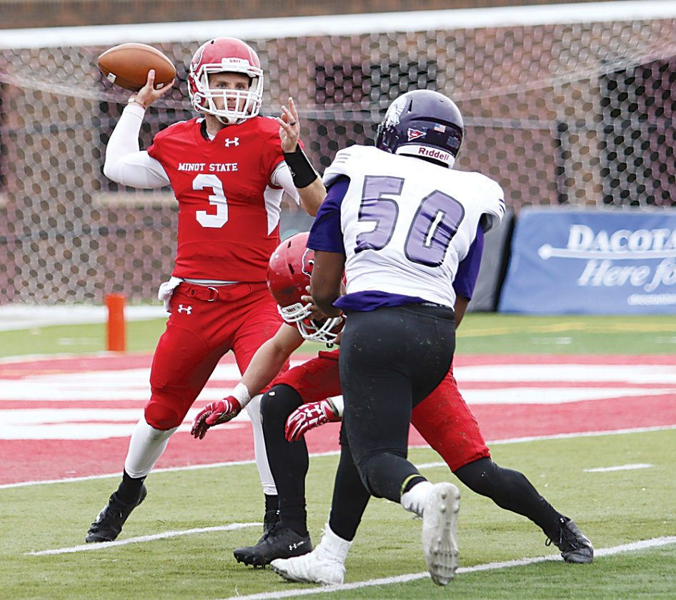 Sean Arbaut/Minot State athletics Minot State quarterback Andy Jones (3) throws a pass downfield during a college football game Saturday.