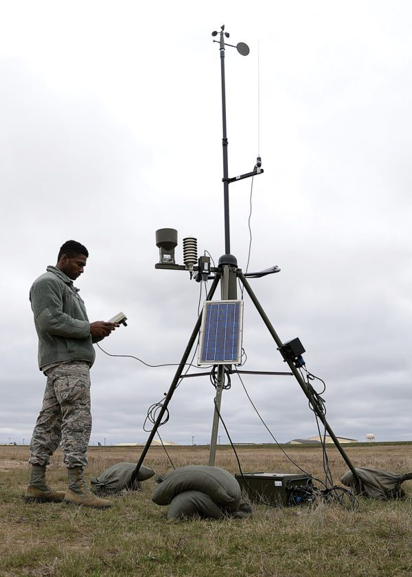 Submitted Photo Airman 1st Class Errol Petgrave, 5th Operations Support Squadron weather forecaster, inspects the Deployed Tactical Meteorological Observing System for damage at Minot Air Force Base, April 18, shown in this photo by Airman 1st Class Dillon J. Audit. Petgrave is checking the statistics and the raw data from the TMQ-53, which afterwards sends the data to their computer.