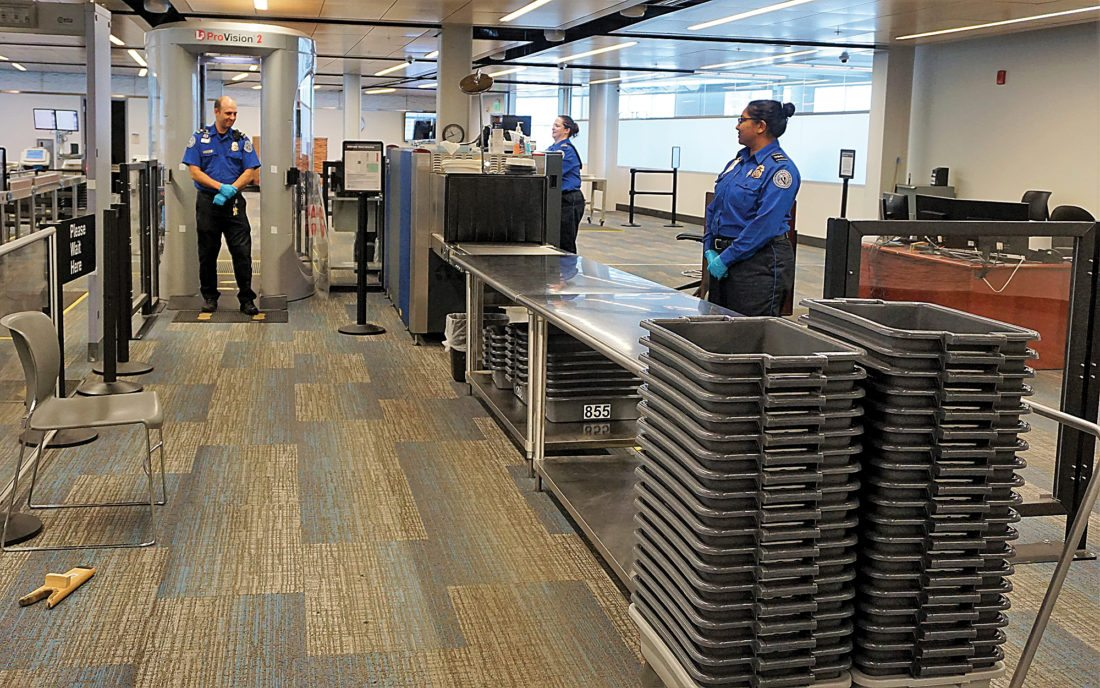 Jill Schramm/MDN TSA personnel stand ready to screen passengers at the Minot airport Sept. 21.