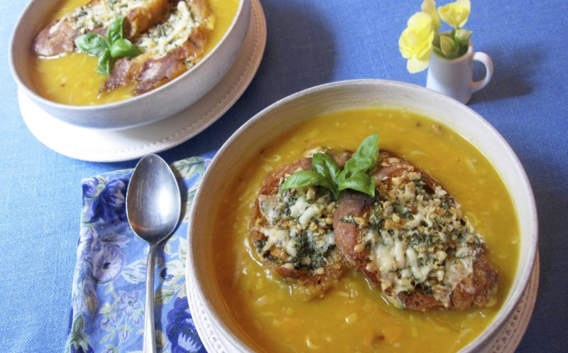 This Sept. 21, 2017 photo shows butternut squash and leek soup with gruyere pesto toast in New York. This dish is from a recipe by Sara Moulton. (Sara Moulton via AP)