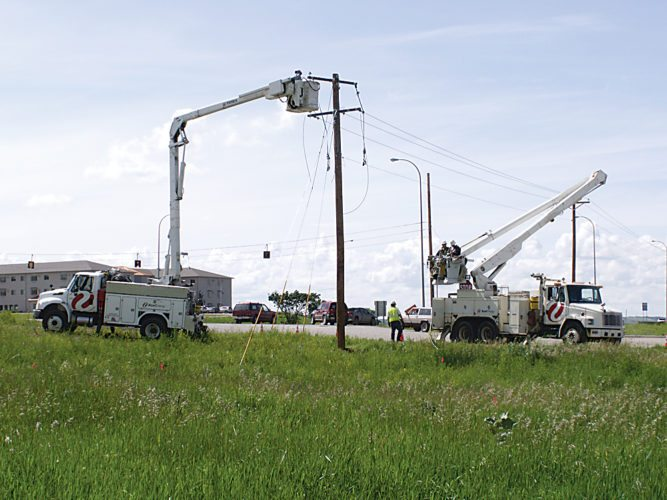 Submitted Photo Xcel Energy crews work on a electrical line in Minot.