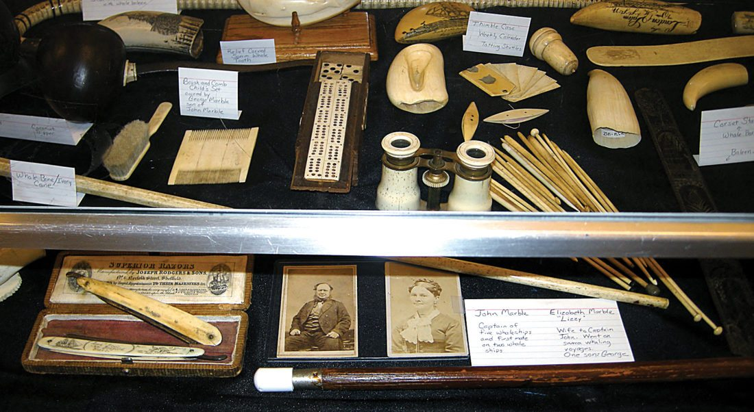 Andrea Johnson/MDN Items made of whale bone and other artifacts are on display at the Minot Public Library.