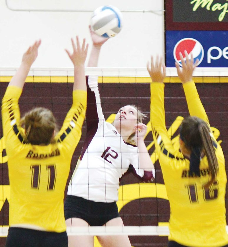Minot High junior Sydney Beck (12) attacks the ball in a West Region game against Turtle Mountain Community High School in Minot. The Majettes won 3-0 by set scores of 25-4, 25-7, 25-6.  Alex Eisen/MDN