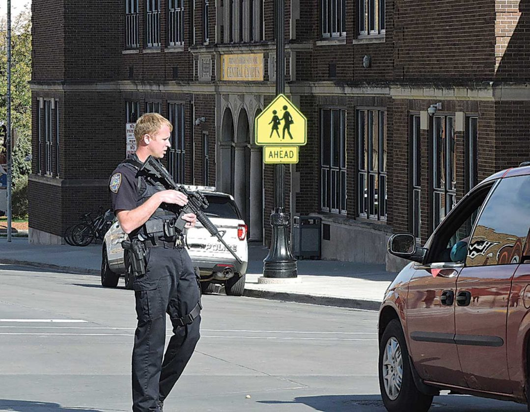 Kim Fundingsland/MDN Minot police cordoned off Central Campus in downtown Minot shortly after noon Wednesday due to a bomb threat.  All students were evacuated.