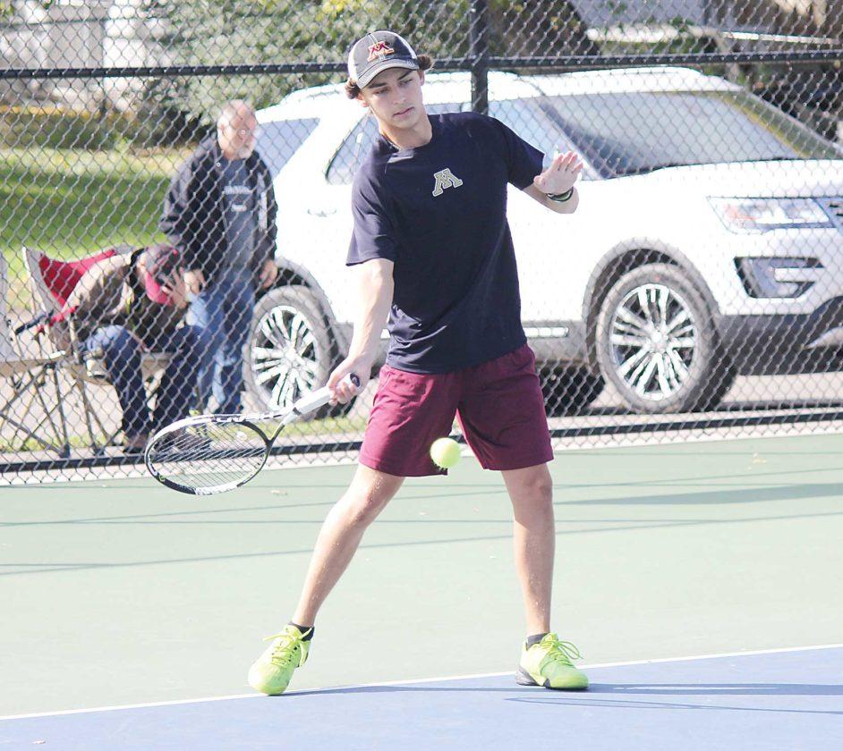 Alex Eisen/MDN Minot High junior Mason Diehl competes in a match against Mandan earlier this season at Hammond Park in Minot.