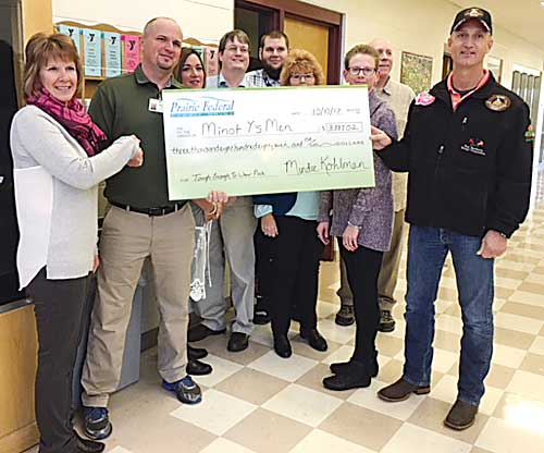 Submitted Photo Prairie Federal recently presented a check, following a Sept. raffle auction, to the Minot Y's Men to benefit the Trinity Cancer Care Rehabilitation Program at the YMCA. The check presented was for $3,887.02.