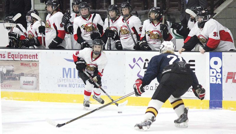 Alex Eisen/MDN Minot State's Angela Lothspeich (15) skates in front of her bench in a game against Wisconsin-Eau Claire Sunday afternoon at Maysa Arena in Minot.