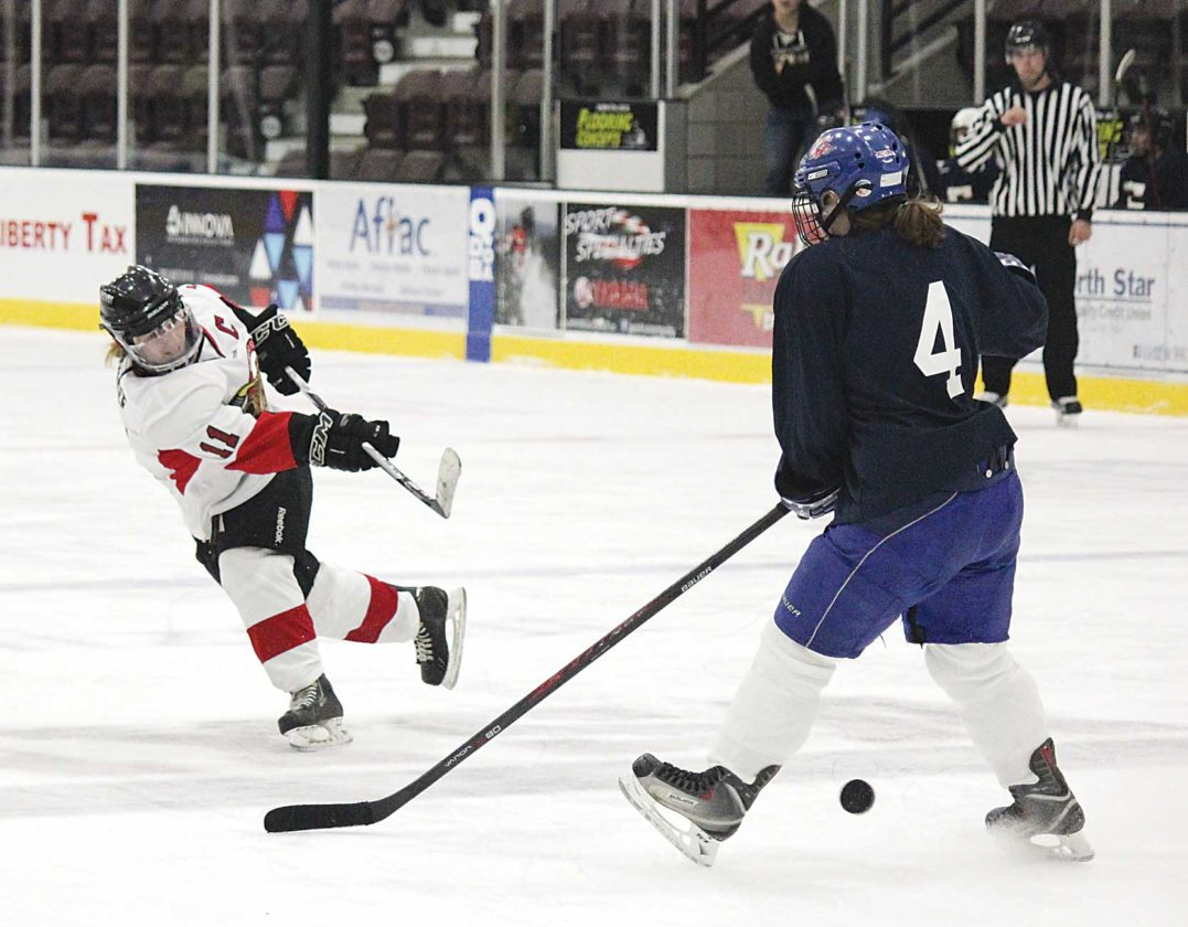 Alex Eisen/MDN Minot State defender Cassidy McGree (11) takes a shot between the legs of Wisconsin-Eau Claire's Jessie Wilkins (4) in a game played Sunday afternoon at Maysa Arena.