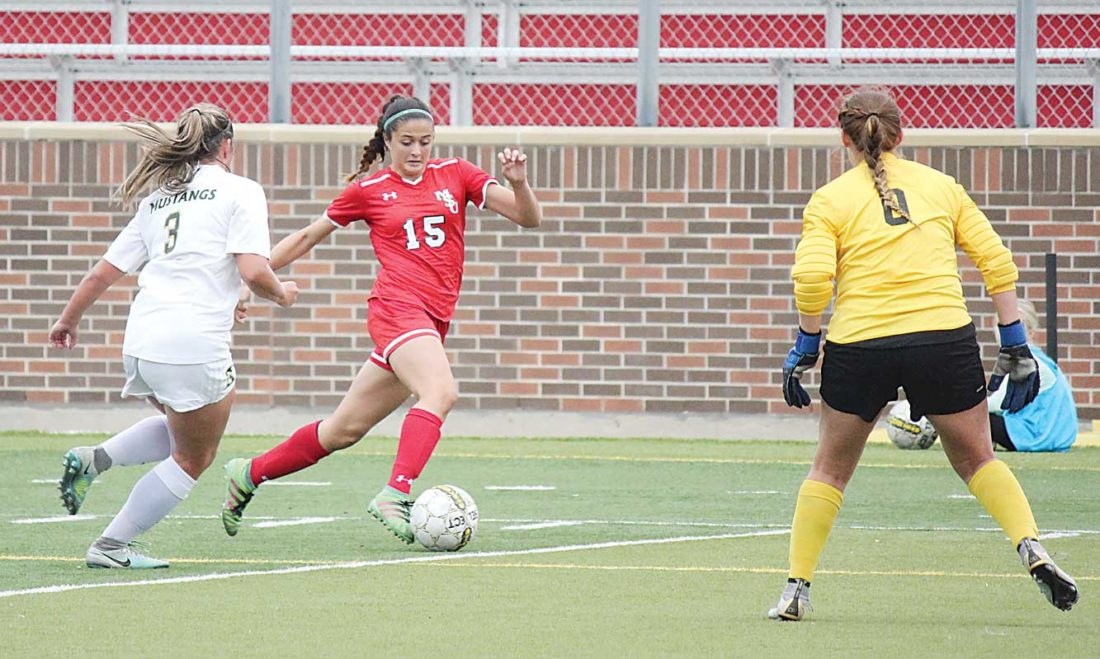 Alex Eisen/MDN Minot State midfielder Sofia Lewis (15) attempts to dribble around a Southwest Minnesota State defender and goalkeeper in a Northern Sun Intercollegiate Conference women's soccer game played earlier this season at Herb Parker Stadium.