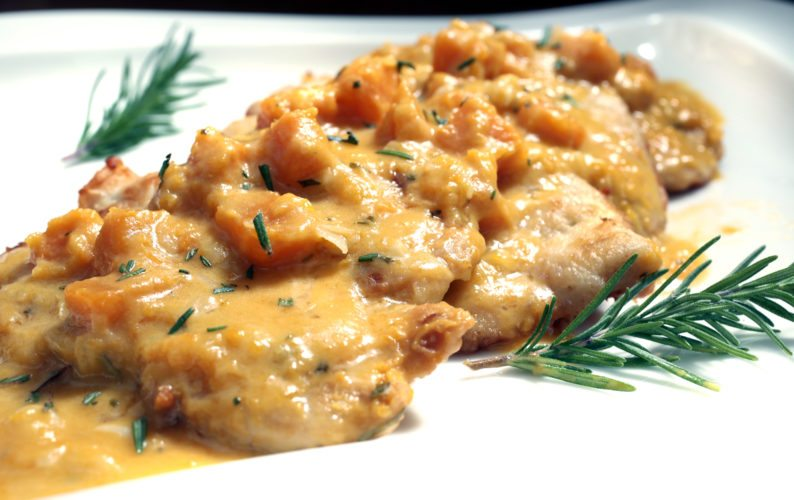 Butternut squash and blue cheese sauce is served over chicken cutlets. Dave Wallis / The Forum