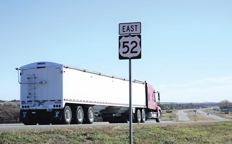 Jill Schramm/MDN A truck leaves Minot Tuesday on U.S. Highway 52 on the portion of four lane highway that exists headed east.