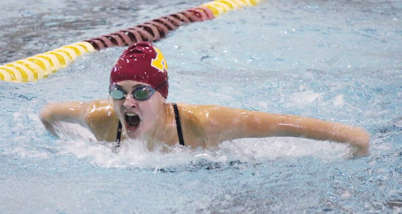 Minot High junior Bella Brooks competes in the 100-yard butterfly Tuesday in a dual meet against Jamestown.