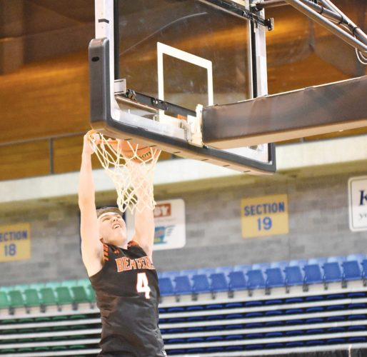 Minot State freshman Kody Dwyer (4) throws down a two-handed dunk during Minot State's late night basketball event Tuesday at the MSU Dome. Dwyer won the dunk contest.   Garrick Hodge/MDN